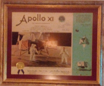 This is another of my most precious possessions. It depicts my participation in the Apollo Xi mission and is signed by the three astronauts who participated in such.